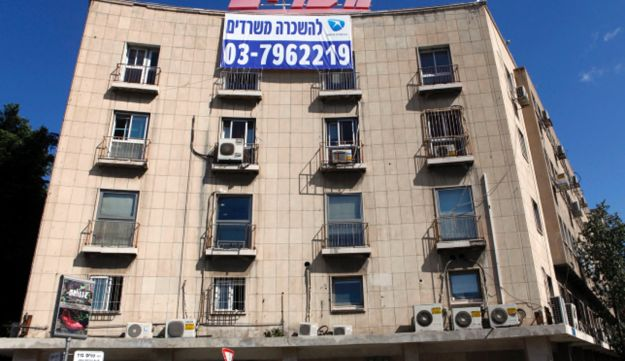 """The Maariv building in Tel Aviv in March, 2011. The sign reads """"Offices for rent."""""""