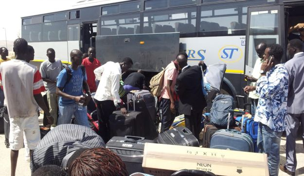 African migrants head to Ben Gurion International Airport to be deported