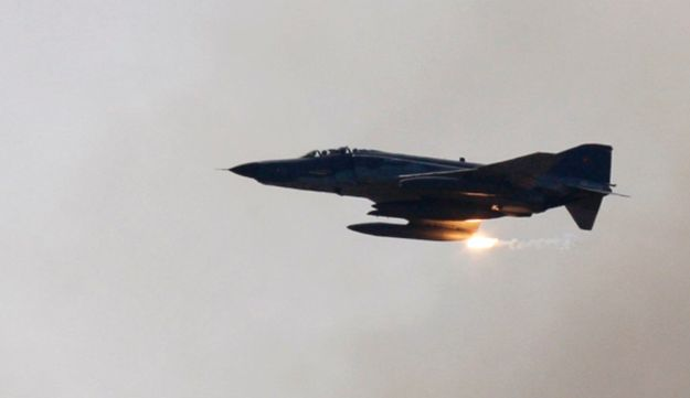 A Turkish Air Force F-4 war plane fires during a military exercise in Izmir, in this May 26, 2010.