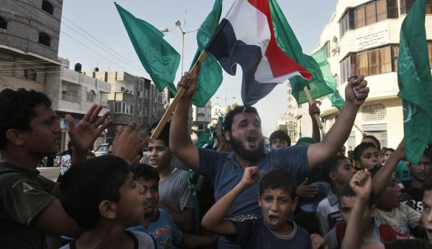 Palestinians wave green Islamic flags in celebration of Mohammed Morsi's election win.