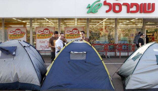 Protest tents outside a supermarket.