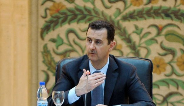 Picture released by the official Syrian Arab News Agency (SANA) of President Assad, June 26, 2012.
