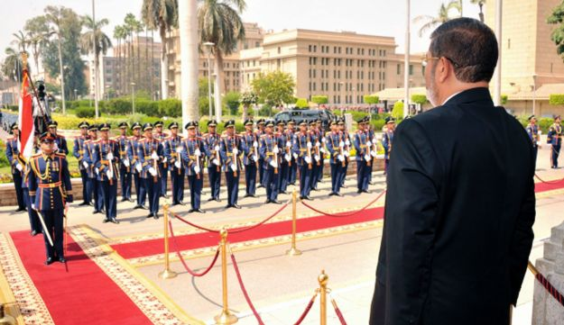 Mohammed Morsi stands before a military honor guard after his inauguration in Cairo.