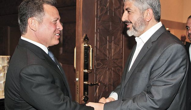 King Abdullah II of Jordan, left, welcoming Hamas' Khaled Meshal at the Royal Palace in Amman.