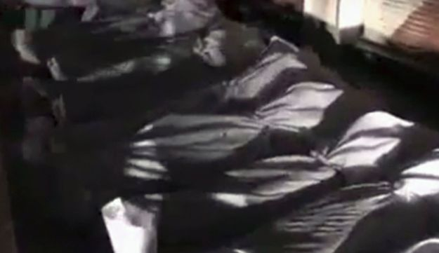 Video grab purporting to show shrouded bodies in Douma, a suburb of Damascus, June 29, 2012.