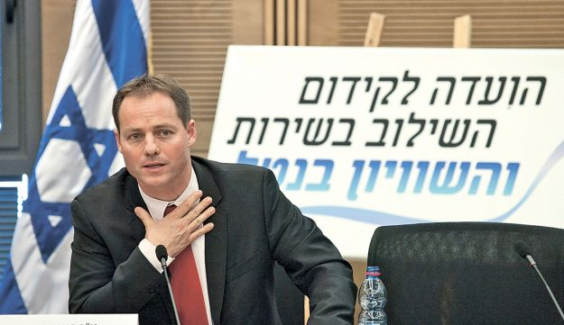 MK Yohanan Plesner, at the Knesset on Wednesday, presenting the findings of the committee he headed.