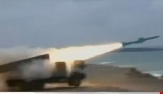 A screengrab from a video released by SANA, showing missiles being launched in a Syrian military exe