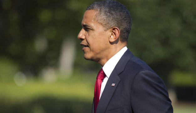 U.S. President Barack Obama arrives on the South Lawn of the White House on July 6, 2012.