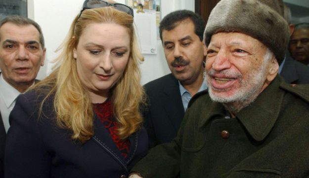 Yasser Arafat and his wife Suha hold hands prior to Arafat's departure from Ramallah, Oct. 29, 2004.