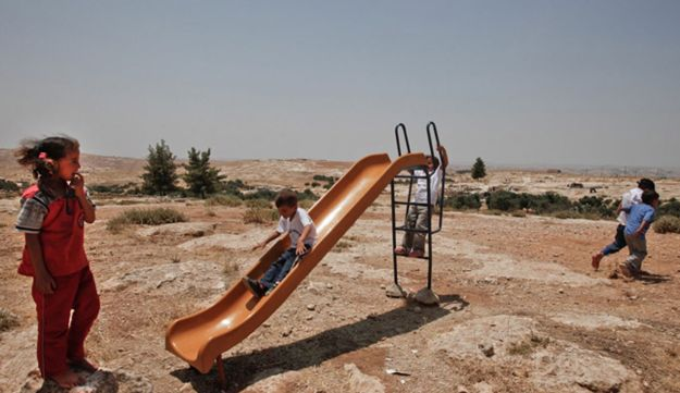 Palestinian children playing in the village of Susya, south of Hebron.