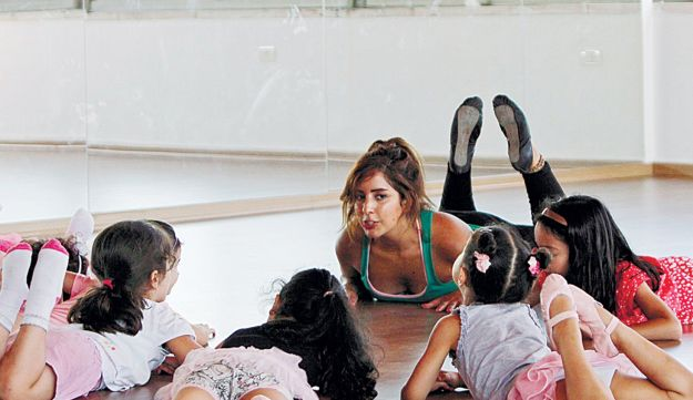 Shyrine Ziadeh, center, owner of a ballet studio in the West Bank city of Ramallah