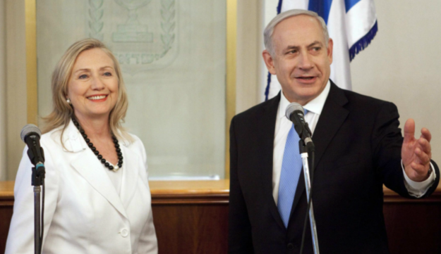 Israel's Prime Minister Benjamin Netanyahu gestures during his meeting with Hillary Clinton