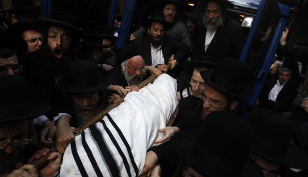 Ultra-Orthodox Jews carry the body of Rabbi Elyashiv to his funeral - Reuters - July 18, 2012