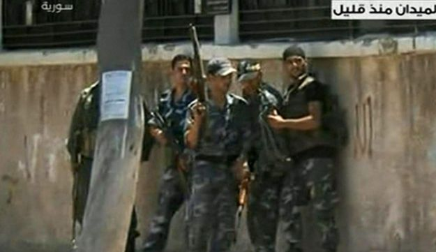 Image made from Syrian State TV video purports to show Syrian troops in Damascus, July 18, 2012.