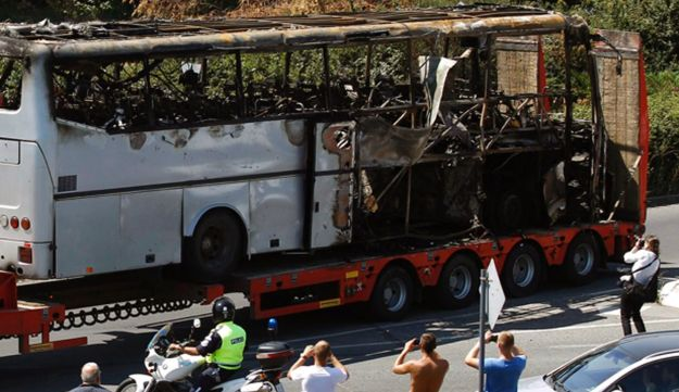 A truck carrying the bus that was damaged in Wednesday's terrorist attack on July 19, 2012.