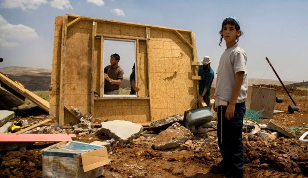 Members of the settler hilltop youth rebuild a structure demolished earlier by Israeli troops in the West Bank outpost of Maoz Esther, near Ramallah. May 2009