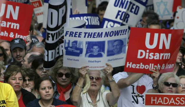 Thousands cheered and wave signs during a pro-Israel solidarity rally near the United Nations.