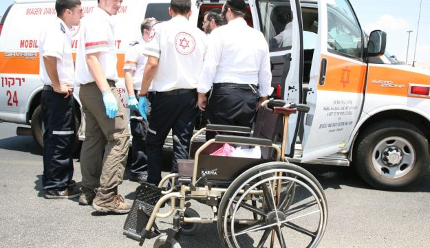 Israeli rescue services evacuating a man who set himself on fire in Yehud, July 22, 2012.