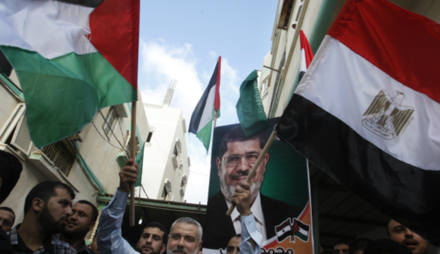 Gaza's Hamas Prime Minister Ismail Haniyeh waves the Palestinian and Egyptian flags