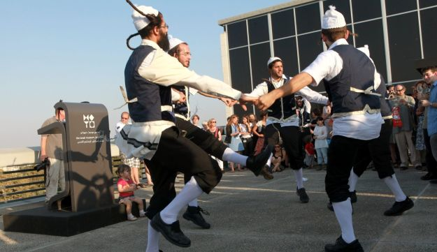 Ultra-Orthodox Jews dance at the Israel Museum