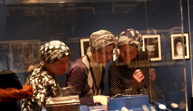 Ultra-Orthodox women view the Hasidic exhibit in Jerusalem