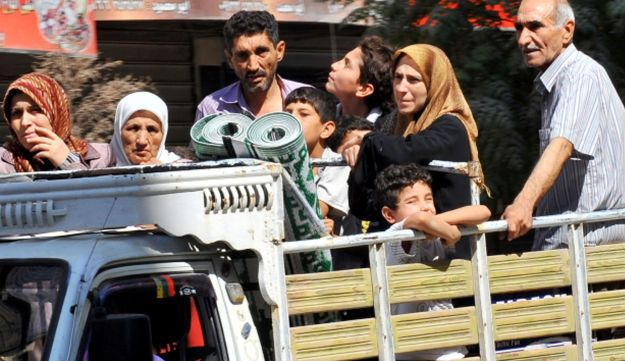 Syrian people leave Aleppo after shelling by Syrian government forces, July 26, 2012.