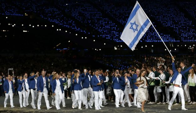 Israel's flag bearer Shahar Zubari leads the contingent in Olympics opening ceremony