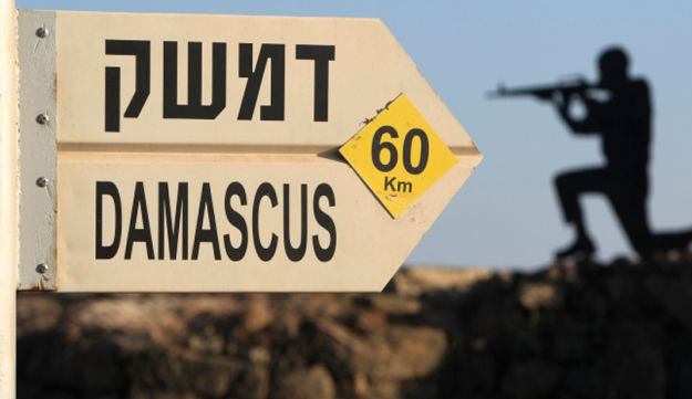 A sign showing the distances to Damascus at an army post from the 1967 war at Mt. Bental.