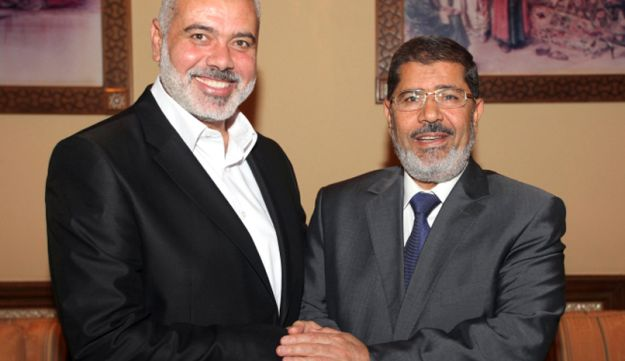 Egyptian President Mohammed Morsi, right, meets the Hamas Prime Minister of Gaza, Ismail Haniyeh.