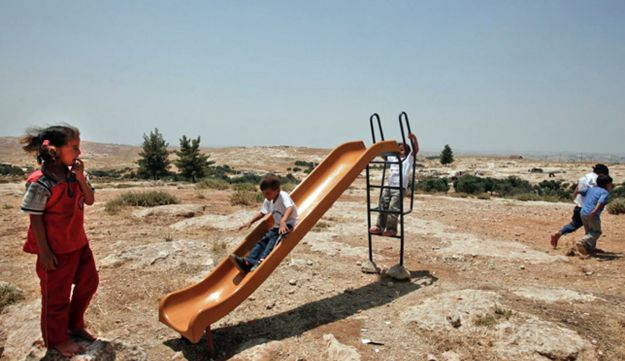 Palestinian children play in the village of Susia, south of Hebron.