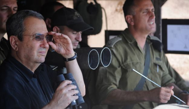 Defense Minister Ehud Barak at an IDF post in the Golan Heights.