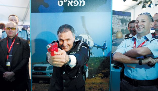 On target: Police chief Yohanan Danino posing at a convention earlier this year.