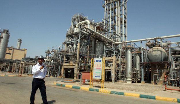 An Iranian security guard stands at the Maroun Petrochemical plant at the Imam Khomeini port