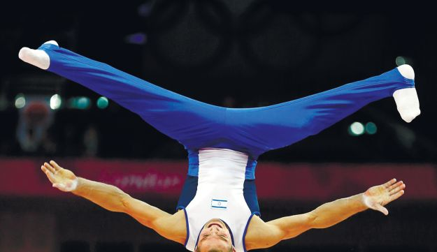 Alex Shatilov competing on the parallel bars during the individual all-around final in London.