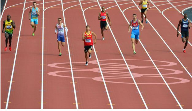THESE SHOES ARE MADE FOR RUNNING: Donald Sanford, far right, in the 400m heats on August 4, 2012.