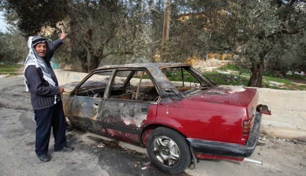 A torched car Palestinians in the West Bank - AP