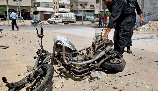 A Hamas member examining the site of the air strike in Gaza Sunday.