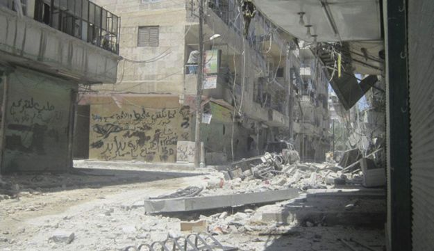 Buildings damaged by what activists say is shelling by forces loyal to Syrian President Bashar Assad