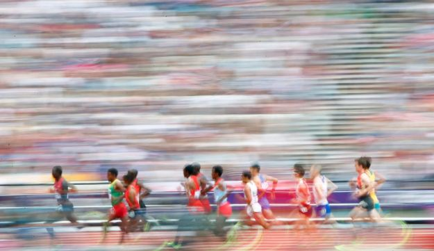 Athletes compete in their men's 5000m round 1 heat at the London 2012 Olympic Games on August 8