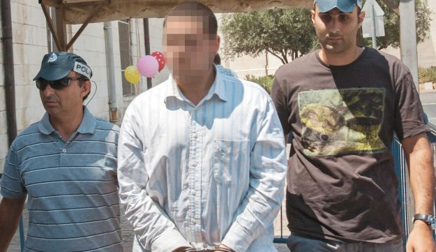 One of the suspects in the Jerusalem attack being brought to court on August 19, 2012.