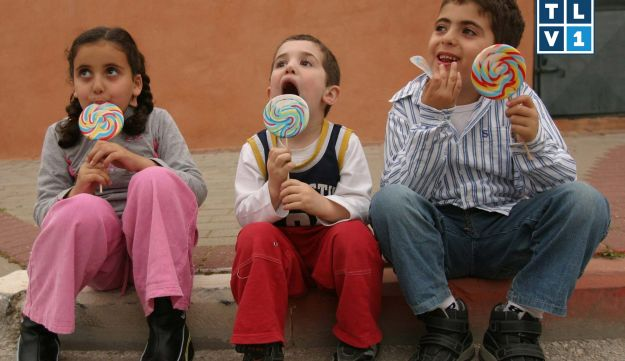 Children eating a lollipop
