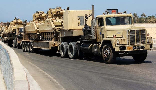 Army trucks carry Egyptian military tanks in El Arish - AP - August 9, 2012