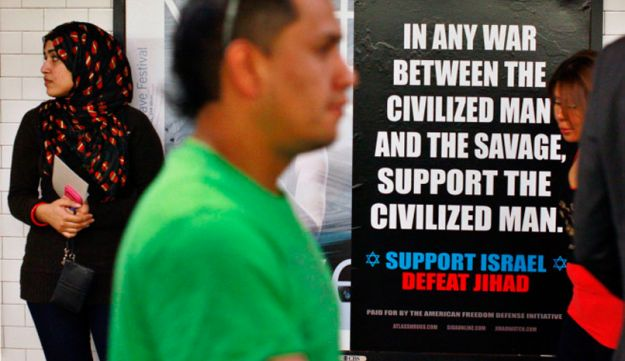Commuters walk by the anti-Jihad poster in New York.