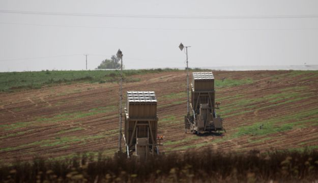 Two Iron Dome systems deployed in a field.