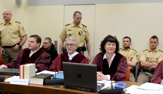Judges and police officers wait for the opening of the third session of the trial