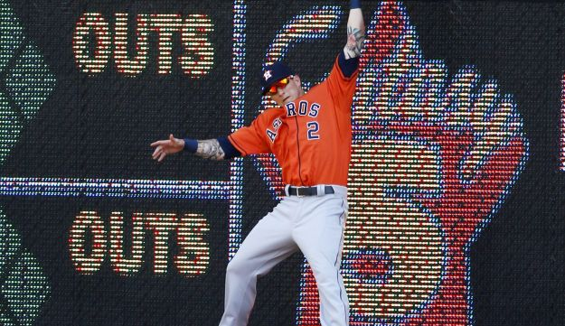 Center fielder Brandon Barnes #2 of the Houston Astros goes up against the wall to catch a fly ball