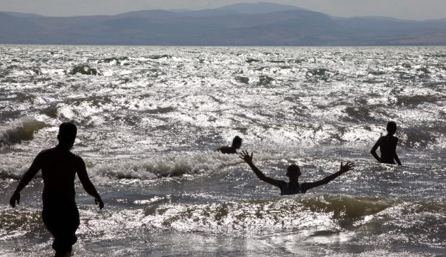 Bathing in the Kinneret.