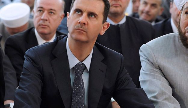 Syria's President Bashar Assad attends Eid Al Fitr prayers - Reuters - August 19, 2012.