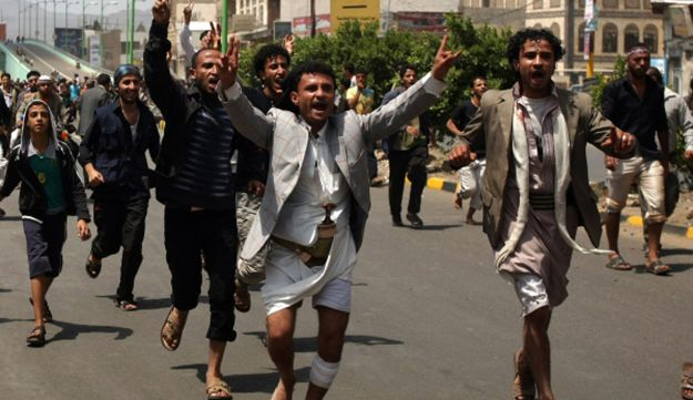 Yemeni protesters shout slogans during a protest against anti-Islam film