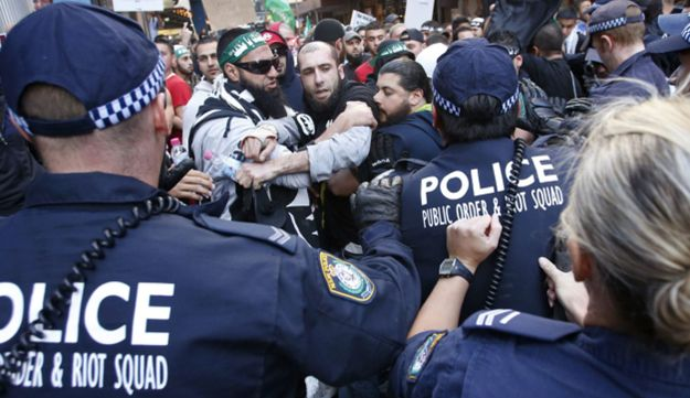 Protesters clash with police on a street in Sydney's central business district, Sept. 15, 2012.